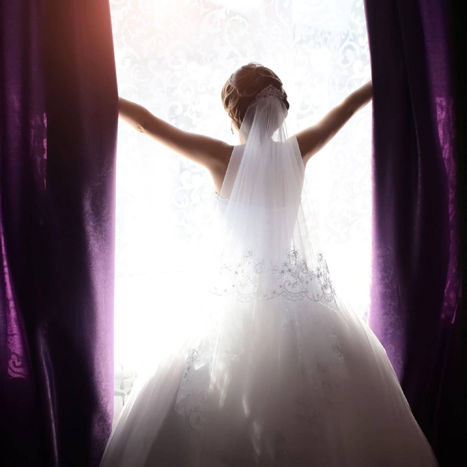 Bride in daylight window opening